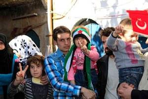 Syrian refugees receiving humanitarian aid from Hizmet volunteers.